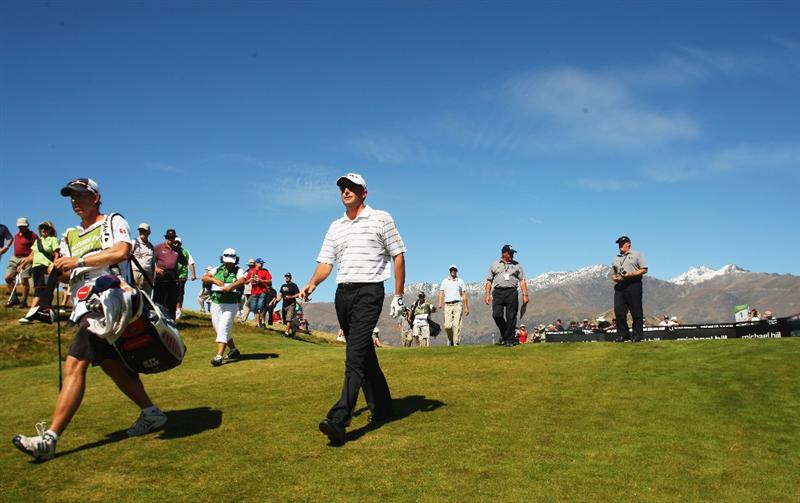 QUEENSTOWN, NEW ZEALAND - MARCH 14:  Jeff Gove of the USA walks down the fairway on the 1st hole during day three of the New Zealand Men's Open Championship at The Hills Golf Club on March 14, 2009 in Queenstown, New Zealand.  (Photo by Phil Walter/Getty Images)
