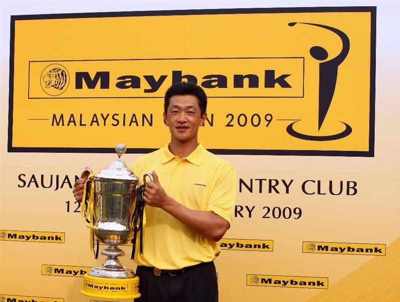 KUALA LUMPUR, MALAYSIA - FEBRUARY 15:  Anthony Kang of USA poses with the trophy after winning the Final round of the 2009 Maybank Malaysian Open at Saujana Golf and Country Club on February 15, 2009 in Kuala Lumpur, Malaysia.  (Photo by Ian Walton/Getty Images)