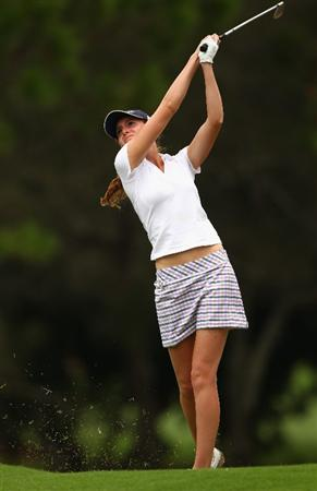 GOLD COAST, AUSTRALIA - MARCH 06:  Florentyna Parker of England hits an iron shot on the 3rd hole during round three of the 2010 ANZ Ladies Masters at Royal Pines Resort on March 6, 2010 in Gold Coast, Australia.  (Photo by Ryan Pierse/Getty Images)