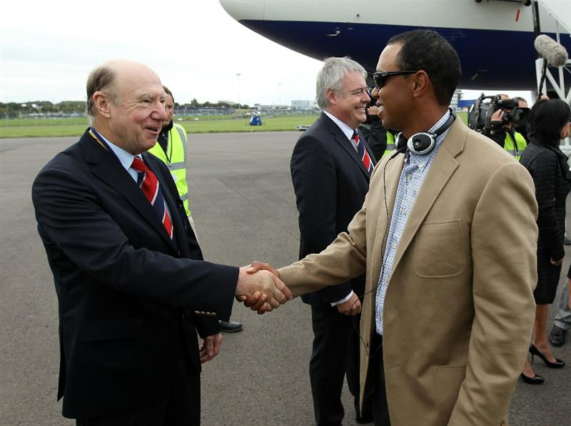 CARDIFF AIRPORT - SEPTEMBER 27: In this handout image provided by Ryder Cup Europe, John Jermine, chairman of Ryder Cup Wales welcomes Tiger Woods as the US team arrive at Cardiff Airport prior to the start of the 2010 Ryder Cup on September 27, 2010 in Cardiff, Wales.  (Photo by Ryder Cup Europe via Getty Images).