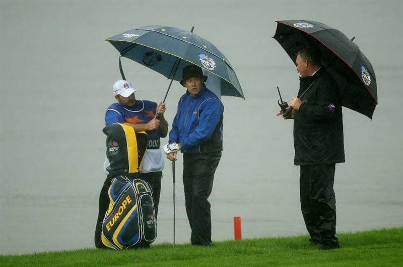 NEWPORT, WALES - OCTOBER 01:  Lee Westwood of Europe chats with rules official Andy McFee as his caddie Billy Foster waits on the sixth hole during the Morning Fourball Matches during the 2010 Ryder Cup at the Celtic Manor Resort on October 1, 2010 in Newport, Wales.  (Photo by Ross Kinnaird/Getty Images)