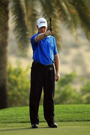 DUBAI, UNITED ARAB EMIRATES - FEBRUARY 10:  Todd Hamilton of the USA putts at the 8th hole during the first round of the 2011 Omega Dubai Desert Classic on the Majilis Course at the Emirates Golf Club on February 10, 2011 in Dubai, United Arab Emirates.  (Photo by David Cannon/Getty Images)