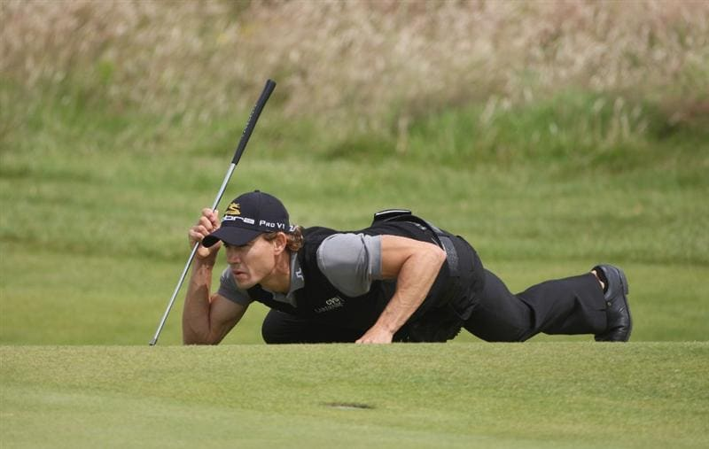 TURNBERRY, SCOTLAND - JULY 18:  Camilo Villegas of Colombia lines up a putt during round three of the 138th Open Championship on the Ailsa Course, Turnberry Golf Club on July 18, 2009 in Turnberry, Scotland.  (Photo by Andrew Redington/Getty Images)
