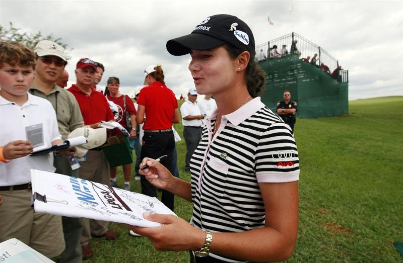 PRATTVILLE, AL - OCTOBER 2:  Lorena Ochoa of Mexico signs autographs for fans following her second round play in the Navistar LPGA Classic at the Robert Trent Jones Golf Trail at Capitol Hill on October 2, 2009 in  Prattville, Alabama.  (Photo by Dave Martin/Getty Images)
