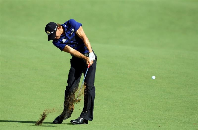 DUBAI, UNITED ARAB EMIRATES - NOVEMBER 21:  Camilo Villegas of Colombia plays his second shot at the 8th hole during the third round of the Dubai World Championship, on the Earth Course, Jumeirah Golf Estates on November 21, 2009 in Dubai, United Arab Emirates  (Photo by David Cannon/Getty Images)