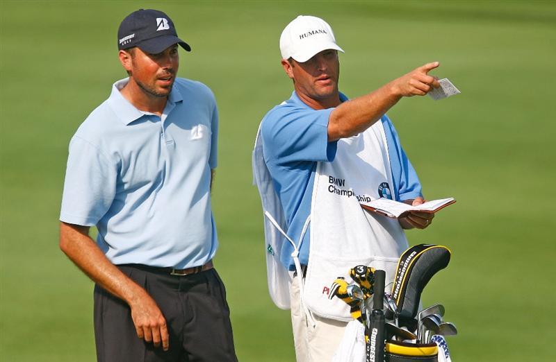 LEMONT, IL - SEPTEMBER 12:  Matt Kuchar chats with his caddie Lance Bennett on the 18th hole during the third round of the BMW Championship held at Cog Hill Golf & CC on September 12, 2009 in Lemont, Illinois.  (Photo by Scott Halleran/Getty Images)