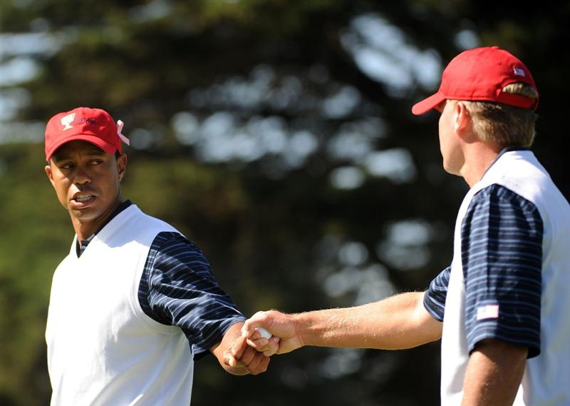 SAN FRANCISCO - OCTOBER 09:  Tiger Woods of the USA Team celebrates his putt to win the 6th hole with Steve Stricker during the Day Two Fourball Matches of The Presidents Cup at Harding Park Golf Course on October 9, 2009 in San Francisco, California.  (Photo by Harry How/Getty Images)