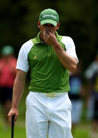 SUN CITY, SOUTH AFRICA - DECEMBER 05:  Sergio Garcia of Spain reacts to a poor putt on the 11th green during the second round of the Nedbank Golf Challenge at the Gary Player Country Club on December 5, 2008 in Sun City, South Africa.  (Photo by Richard Heathcote/Getty Images)