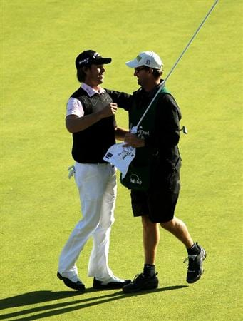 PACIFIC PALISADES, CA - FEBRUARY 20:  Aaron Baddeley of Australia celebrates with caddie Anthony Knight after making the winning putt during the final round of the Northern Trust Open at Riviera Country Club on February 20, 2011 in Pacific Palisades, California.  (Photo by Stephen Dunn/Getty Images)