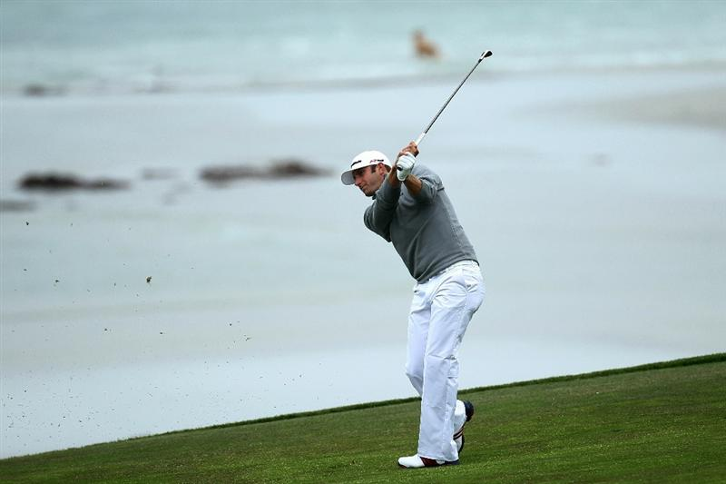 PEBBLE BEACH, CA - JUNE 18:  Dustin Johnson hits his second shot on the tenth hole during the second round of the 110th U.S. Open at Pebble Beach Golf Links on June 18, 2010 in Pebble Beach, California.  (Photo by Stephen Dunn/Getty Images)