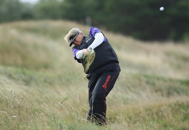 LYTHAM ST ANNES, UNITED KINGDOM - JULY 30:  Laura Davies of England hits her second shot on the 4th hole during the first round of the 2009 Ricoh Women's British Open Championship held at Royal Lytham St Annes Golf Club, on July 30, 2009 in  Lytham St Annes, England. (Photo by David Cannon/Getty Images)