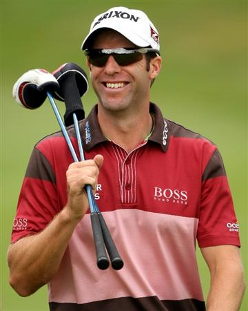 CRANS, SWITZERLAND - SEPTEMBER 03:  Bradley Dredge of Wales smiles as he walks to his ball on the 12th hole during the first round of The Omega European Masters at Crans-Sur-Sierre Golf Club on September 3, 2009 in Crans Montana, Switzerland.  (Photo by Andrew Redington/Getty Images)