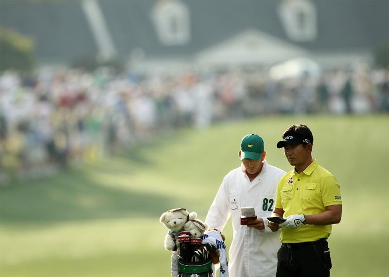 AUGUSTA, GA - APRIL 08:  Y.E. Yang of South Korea chats with his caddie Michael Bestor on the first hole during the second round of the 2011 Masters Tournament at Augusta National Golf Club on April 8, 2011 in Augusta, Georgia.  (Photo by Jamie Squire/Getty Images)