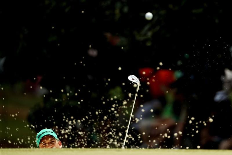 AUGUSTA, GA - APRIL 09:  Sergio Garcia of Spain plays a bunker shot on the first hole during the third round of the 2011 Masters Tournament at Augusta National Golf Club on April 9, 2011 in Augusta, Georgia.  (Photo by Jamie Squire/Getty Images)  *** BESTPIX ***