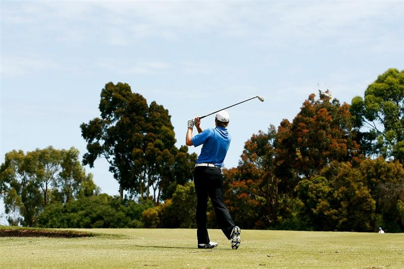 MELBOURNE, AUSTRALIA - NOVEMBER 29:  Michael Sim of Australia plays his second shot on the seventh hole during the third round of the 2008 Australian Masters at Huntingdale Golf Club on November 29, 2008 in Melbourne, Australia  (Photo by Quinn Rooney/Getty Images)