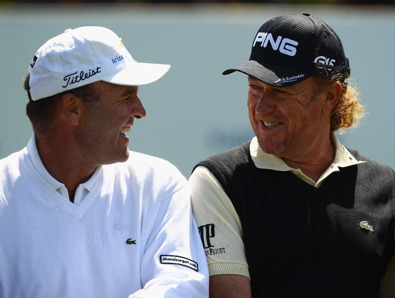 VIRGINIA WATER, ENGLAND - MAY 23:  Thomas Levet of France and Miguel Angel Jimenez of Spain share a joke before the 'Ole Seve' Pro-Am in aid of the Seve Ballesteros Foundation at Wentworth Club on May 23, 2011 in Virginia Water, England.  (Photo by Richard Heathcote/Getty Images)