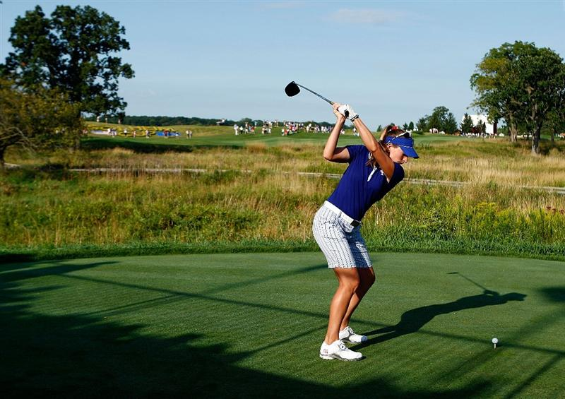 SUGAR GROVE, IL - AUGUST 19:  Brittany Lang of the U.S. Team hits a shot during a practice round prior to the start of the 2009 Solheim Cup at Rich Harvest Farms on August 19, 2009 in Sugar Grove, Illinois.  (Photo by Scott Halleran/Getty Images)