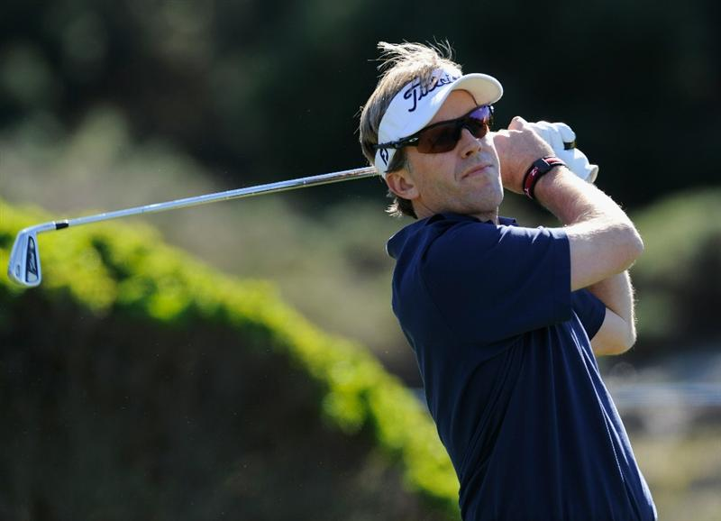 PEBBLE BEACH, CA - FEBRUARY 12:  Brett Quigley plays his tee shot on the fifth hole during the third round of the AT&T Pebble Beach National Pro-Am at the Spyglass Hil Golf Course on February 11, 2011  in Pebble Beach, California  (Photo by Stuart Franklin/Getty Images)