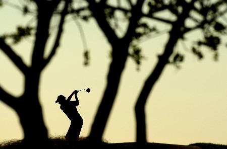 VILAMOURA, PORTUGAL - OCTOBER 19:  Peter Lawrie of Ireland tee's off at the 3rd in the early morning light during the second round of the Portugal Masters at Oceânico Victoria Clube de Golfe on 19 October, 2007 in Vilamoura, Portugal.  (Photo by Richard Heathcote/Getty Images)