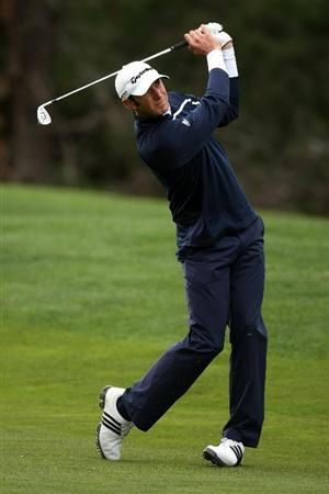 PEBBLE BEACH, CA - FEBRUARY 14:  Dustin Johnson hits his second shot on the 10th hole during the third round of the AT&T Pebble Beach National Pro-Am at Poppy Hills Golf Course on February 14, 2009 in Pebble Beach, California.  (Photo by Stephen Dunn/Getty Images)
