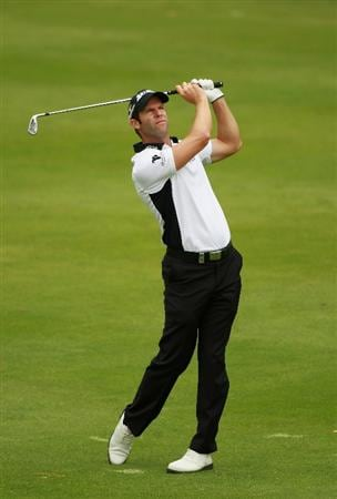 ESTORIL, PORTUGAL - JUNE 12:  Bradley Dredge of Wales plays his second shot into the third green during the third round of the Estoril Open de Portugal at Penha Longa Hotel Spa and Golf Club on June 12, 2010 in Estoril, Portugal.  (Photo by Warren Little/Getty Images)