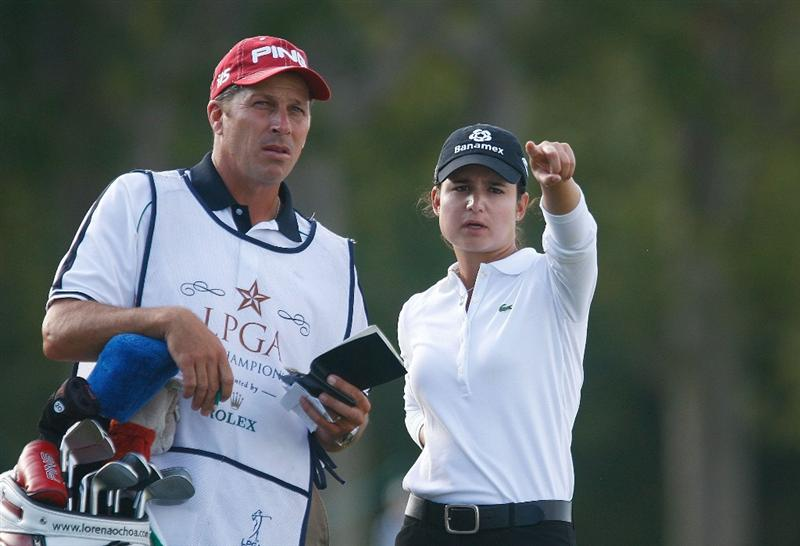 RICHMOND, TX - NOVEMBER 23:  Lorena Ochoa of Mexico chats with her caddie Greg Johnston on the 16th hole during the final round of the LPGA Tour Championship presented by Rolex at the Houstonian Golf and Country Club on November 23, 2009 in Richmond, Texas.  (Photo by Scott Halleran/Getty Images)