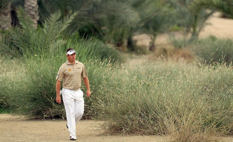 DUBAI, UNITED ARAB EMIRATES - FEBRUARY 06:  Lee Westwood of England walks to his second shot at the 16th hole during the third round of the 2010 Omega Dubai Desert Classic on the Majilis Course at the Emirates Golf Club on February 6, 2010 in Dubai, United Arab Emirates.  (Photo by David Cannon/Getty Images)