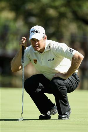 SUN CITY, SOUTH AFRICA - DECEMBER 05:  Lee Westwood of England lines up a putt on the 14th green during the final round of the 2010 Nedbank Golf Challenge at the Gary Player Country Club Course  on December 5, 2010 in Sun City, South Africa.  (Photo by Warren Little/Getty Images)