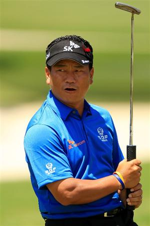 PONTE VEDRA BEACH, FL - MAY 15:  K.J. Choi of South Korea reacts on the second hole green during the final round of THE PLAYERS Championship held at THE PLAYERS Stadium course at TPC Sawgrass on May 15, 2011 in Ponte Vedra Beach, Florida.  (Photo by Streeter Lecka/Getty Images)