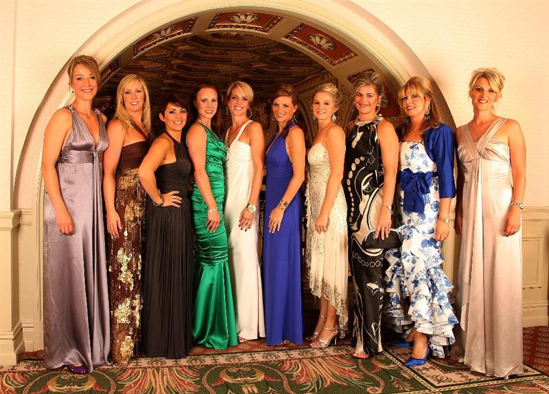 LOUISVILLE, KY - SEPTEMBER 17:  (L-R) Anne Haghfelt, Caroline Harrington, Laurea Westwood, Jocelyn Hefner, Valerie Faldo, Kate Rose, Lauren Smith, Ebba Karlsson, Monteserrat Bravo Ramirez and Emma Stenson, the wives and partners of the European Ryder Cup team, pose before the Ryder Cup Gala inside the Brown Hotel prior to the start of the 2008 Ryder Cup on September 17, 2008 in Louisville, Kentucky.  (Photo by David Cannon/Getty Images)