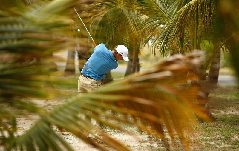 RIO GRANDE, PR - MARCH 12:  Charles Howell III hits out of the trees on the second hole during the first round of the 2009 Puerto Rico Open presented by Banco Popular on March 12, 2009 at the Trump International Golf Club in Rio Grande, Puerto Rico.  (Photo by Mike Ehrmann/Getty Images)