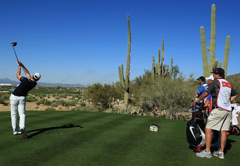 MARANA, AZ - FEBRUARY 26:  Oliver Wilson of England hits his tee shot on the second hole during the second round of the Accenture Match Play Championship at the Ritz-Carlton Golf Club at Dove Mountain on February 26, 2009 in Marana, Arizona.  (Photo by Scott Halleran/Getty Images)