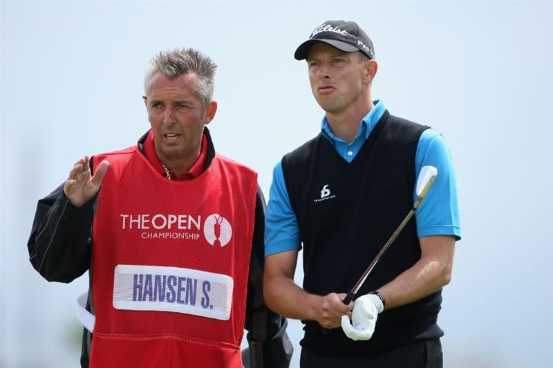 TURNBERRY, SCOTLAND - JULY 18:  Caddy Phil Morbey discusses a shot with Soren Hansen of Denmark during round three of the 138th Open Championship on the Ailsa Course, Turnberry Golf Club on July 18, 2009 in Turnberry, Scotland.  (Photo by Andrew Redington/Getty Images)