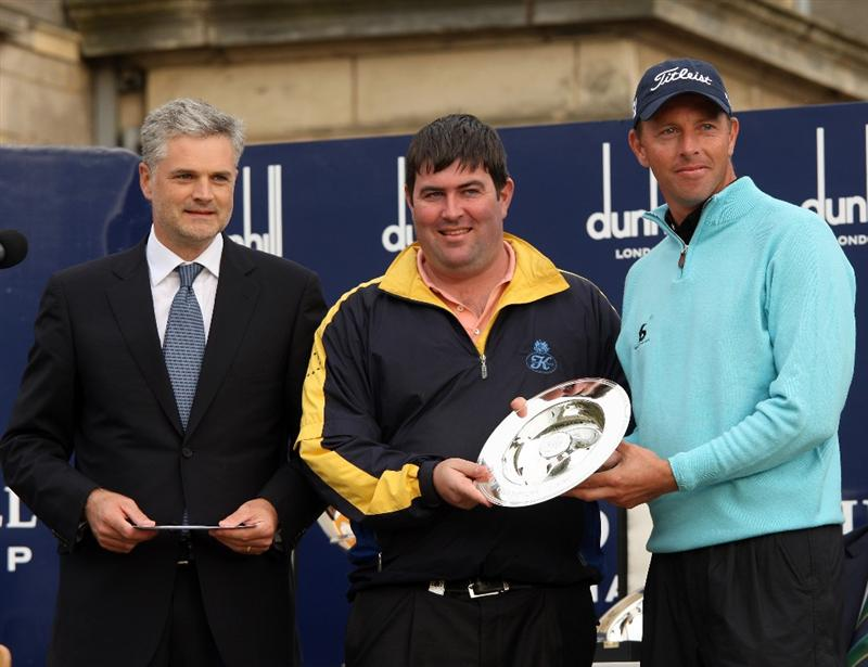 ST ANDREWS, SCOTLAND - OCTOBER 05:  Soren Hansen of Denmark and his playing partner Kieran McManus pose with their trophies with Alfred Dunhill chief executive Christopher Colfer after winning the Team event at The Alfred Dunhill Links Championship at The Old Course on October 5, 2009 in St.Andrews, Scotland.  (Photo by Andrew Redington/Getty Images)