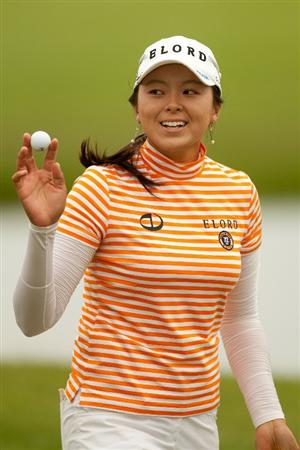 SPRINGFIELD, IL - JUNE 10: M.J. Hur of South Korea smiles and raises her ball to acknowledge the crowd during the first round of the LPGA State Farm Classic at Panther Creek Country Club on June 10, 2010 in Springfield, Illinois. (Photo by Darren Carroll/Getty Images)