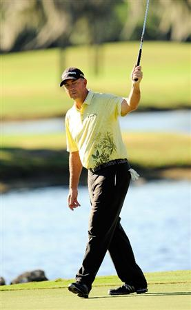 LAKE BUENA VISTA, FL - NOVEMBER 13:  Tom Lehman reacts to a birdie putt on the 16th hole during the second round of the Children's Miracle Network Classic at the Disney Palm and Magnolia courses on November 13, 2009 in Lake Buena Vista, Florida.  (Photo by Sam Greenwood/Getty Images)
