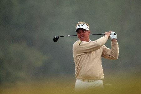 DELHI, INDIA - FEBRUARY 05:  Darren Clarke of Northern Ireland hits his second shot to the 18th green during the Challenge Match, in the Emaar-MGF Indian Masters at the Delhi Golf Club on February 5, 2008 in Delhi, India.  (Photo by David Cannon/Getty Images)