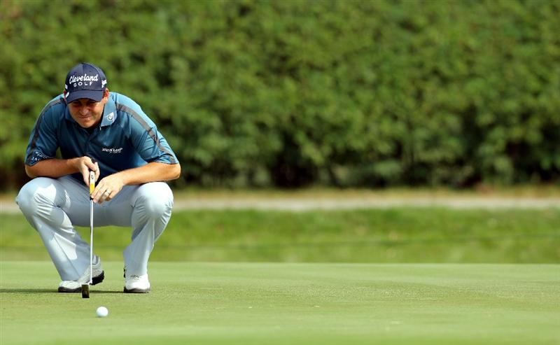 HONG KONG - NOVEMBER 19:  David Howell of England lines up for a putt on the 6th hole during day two of the UBS Hong Kong Open at The Hong Kong Golf Club on November 19, 2010 in Hong Kong, Hong Kong. ( Photo by Stanley Chou/Getty Images )