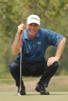 Curtis Strange smiles and lines up a putt on the fourth green  during   the final  round of the 2005 Blue Angels Class  May 15 in Milton, Fl.Photo by Al Messerschmidt/WireImage.com