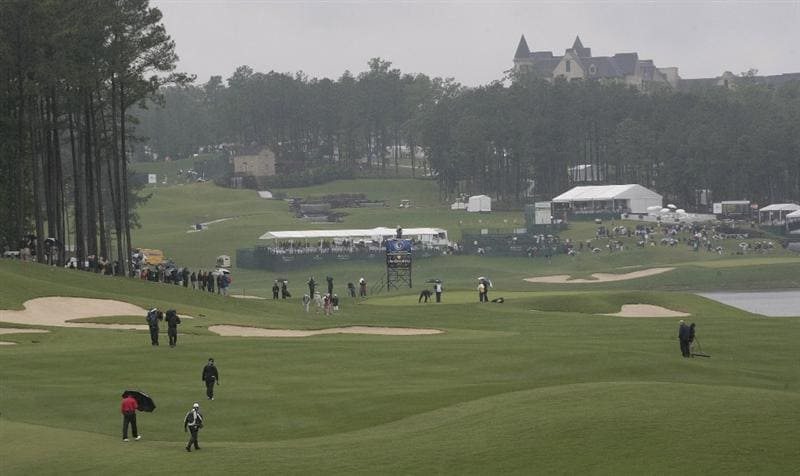 BIRMINGHAM, AL - MAY 17:  Keith Fegus (L) walks to the 17th green during the rain delayed second round of the Regions Charity Classic at the Robert Trent Jones Golf Trail at Ross Bridge on May 17, 2009 in Birmingham, Alabama. (Photo by Dave Martin/Getty Images)