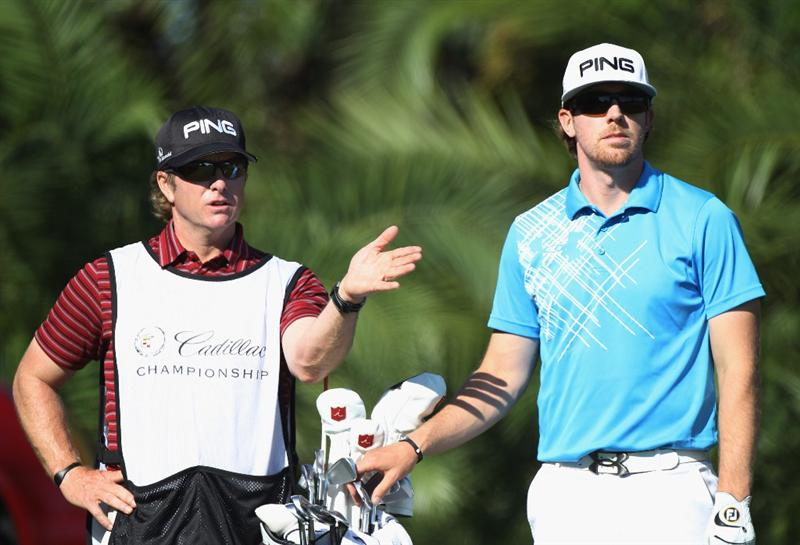 DORAL, FL - MARCH 11:  Hunter Mahan chats with his caddie John Wood on the 15th hole during the second round of the 2011 WGC- Cadillac Championship at the TPC Blue Monster at the Doral Golf Resort and Spa on March 11, 2011 in Doral, Florida.  (Photo by Sam Greenwood/Getty Images)