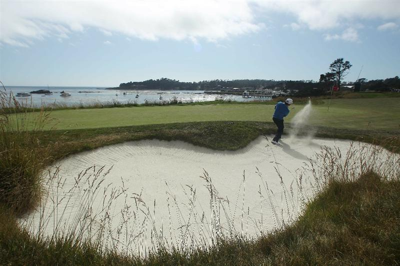 PEBBLE BEACH, CA - JUNE 19:  Graeme McDowell of Northern Ireland plays from a bunker on the fifth green during the third round of the 110th U.S. Open at Pebble Beach Golf Links on June 19, 2010 in Pebble Beach, California.  (Photo by Donald Miralle/Getty Images)