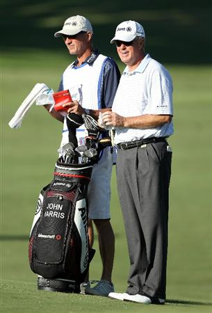 CONOVER, NC - OCTOBER 01:  John Harris stands with his caddy and bag on the first hole during the first round of the Ensure Classic at the Rock Barn Golf & Spa on October 1, 2010 in Conover, North Carolina.  (Photo by Christian Petersen/Getty Images)