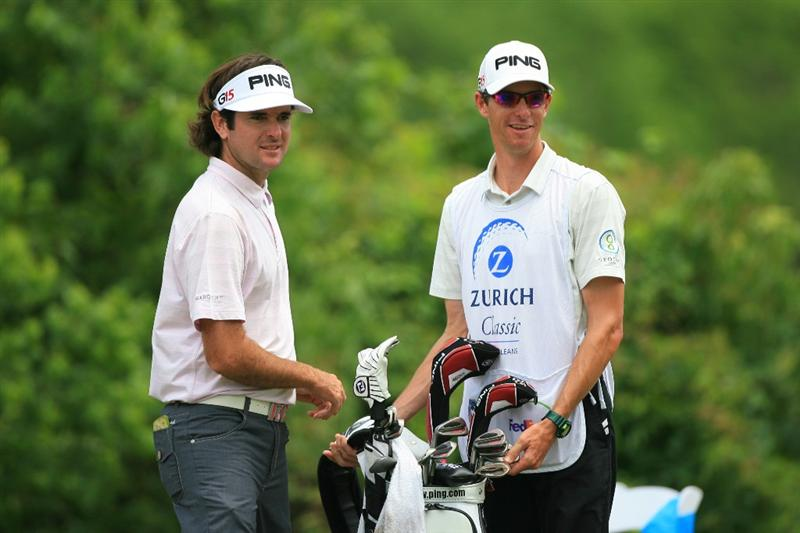 NEW ORLEANS, LA - APRIL 30: Bubba Watson (L) stands with his caddie on the second hole during the third round of the Zurich Classic at the TPC Louisiana on April 30, 2011 in New Orleans, Louisiana. (Photo by Hunter Martin/Getty Images)