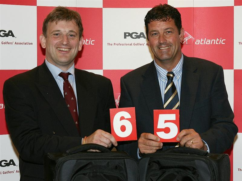 SUTTON COLDFIELD, ENGLAND - JUNE 9:  Winners Andrew Slater (L) and Brian Rimmer of Little Aston pose for a picture during the Virgin Atlantic National Pro-Am Championship Regional Final at Little Aston Golf Club on June 9, 2010 in Sutton Coldfield, England.  (Photo by Jan Kruger/Getty Images)