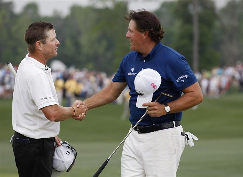 HUMBLE, TX - APRIL 03:  Phil Mickelson (R) is congratulated by playing partner Scott Verplank for winning the Shell Houston Open at Redstone Golf Club on April 3, 2011 in Humble, Texas.  (Photo by Michael Cohen/Getty Images)