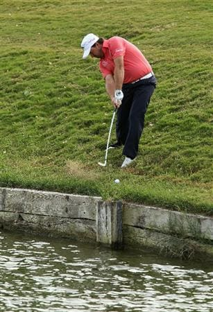SOTOGRANDE, SPAIN - OCTOBER 30:  Graeme McDowell of Northern Ireland hits his approach to the 10th green from the hazard during the third round of the Andalucia Valderrama Masters at Club de Golf Valderrama on October 30, 2010 in Sotogrande, Spain.  (Photo by Richard Heathcote/Getty Images)