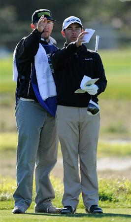 PEBBLE BEACH, CA - FEBRUARY 10:  Chez Reavie  and caddie discuss a shot during the first round of the AT&T Pebble Beach National Pro-Am at Monterey Peninsula Country Club on February 10, 2011  in Pebble Beach, California.  (Photo by Stuart Franklin/Getty Images)
