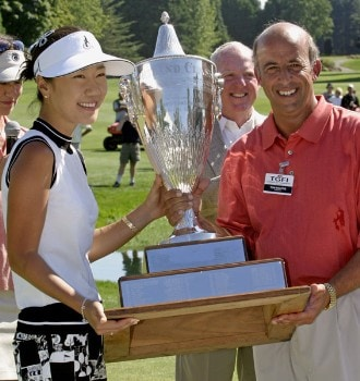 Tournament champion Soo-Yun Kang receives the Safeway Classic trophy from TGFI President Tom Maletis. Kang won her first LPGA event at 15 under par. Shooting a 64, 68, 69 at the 2005 Safeway Classic held at Columbia Edgewater Country Club, Sunday,  August 21, 2005.Photo by Allan Campbell/WireImage.com