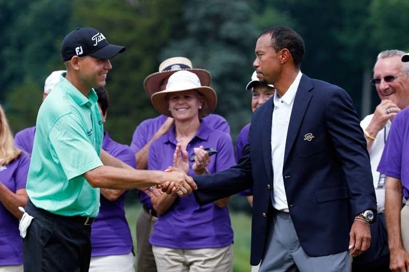 Bill Haas shakes hands with Tiger Woods